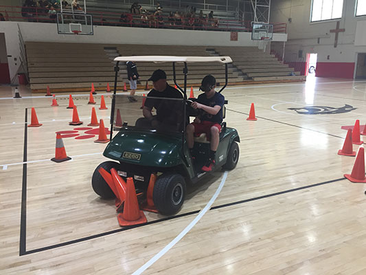 Drunk Goggles and FHS Students with the DARE Officer